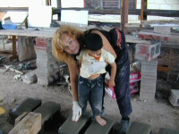 Laury Dizengremel and a Honduran child creating two of the footprints designs