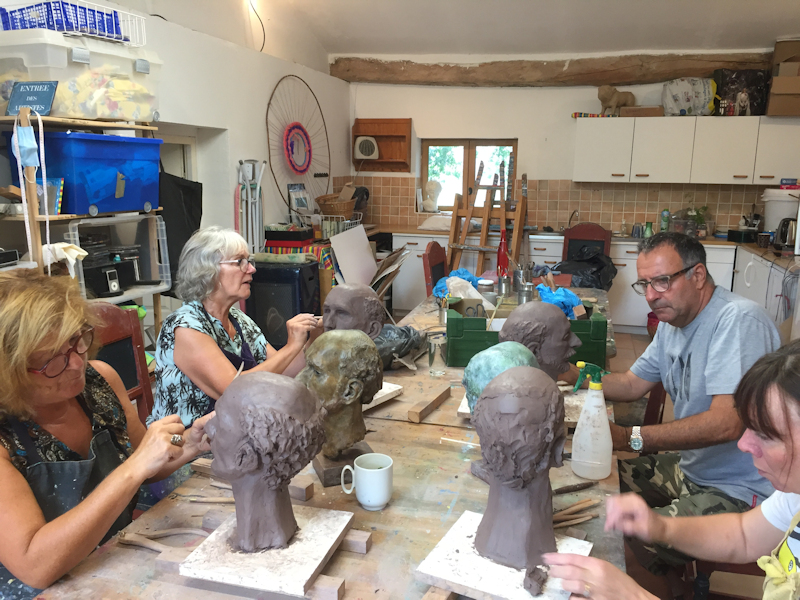 Sculpture students modelling clay busts